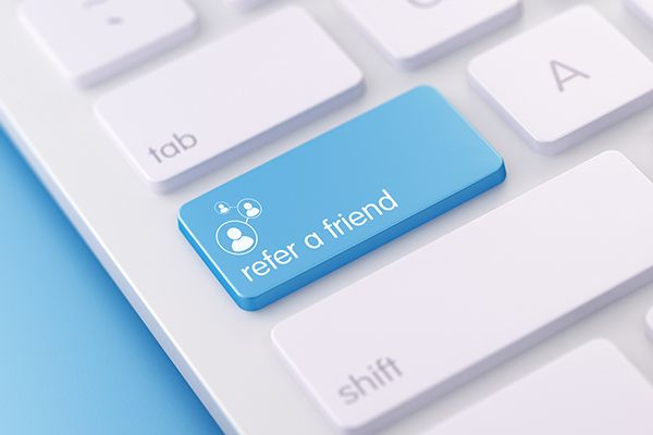 Keyboard with a key named refer a friend as symbol for a tip for OhmConnect savings