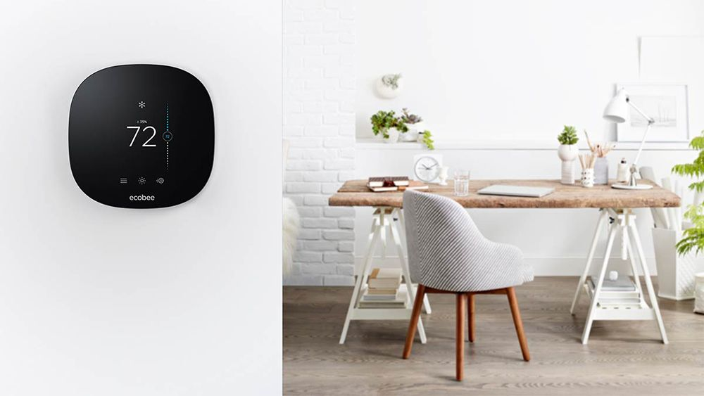 Ecobee smart plu on the wall showing a brown and white desk