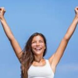 woman stretching her arms in the air celebrating having hit one of 3 MEGA Summer goals