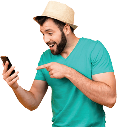 a man in a green t-shirt and a straw hat smiling and pointing at his phone