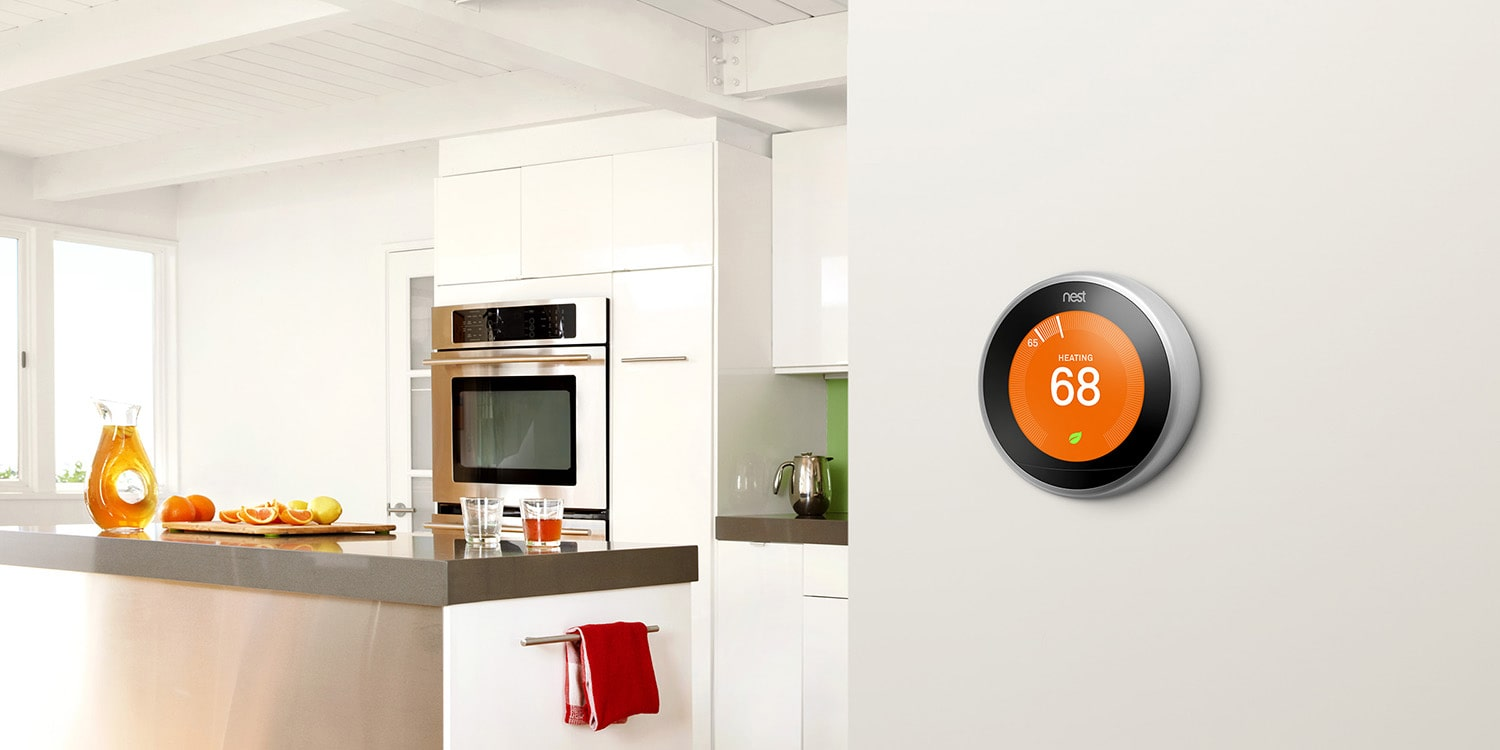 Nest learning thermostat positioned on a kitchen wall