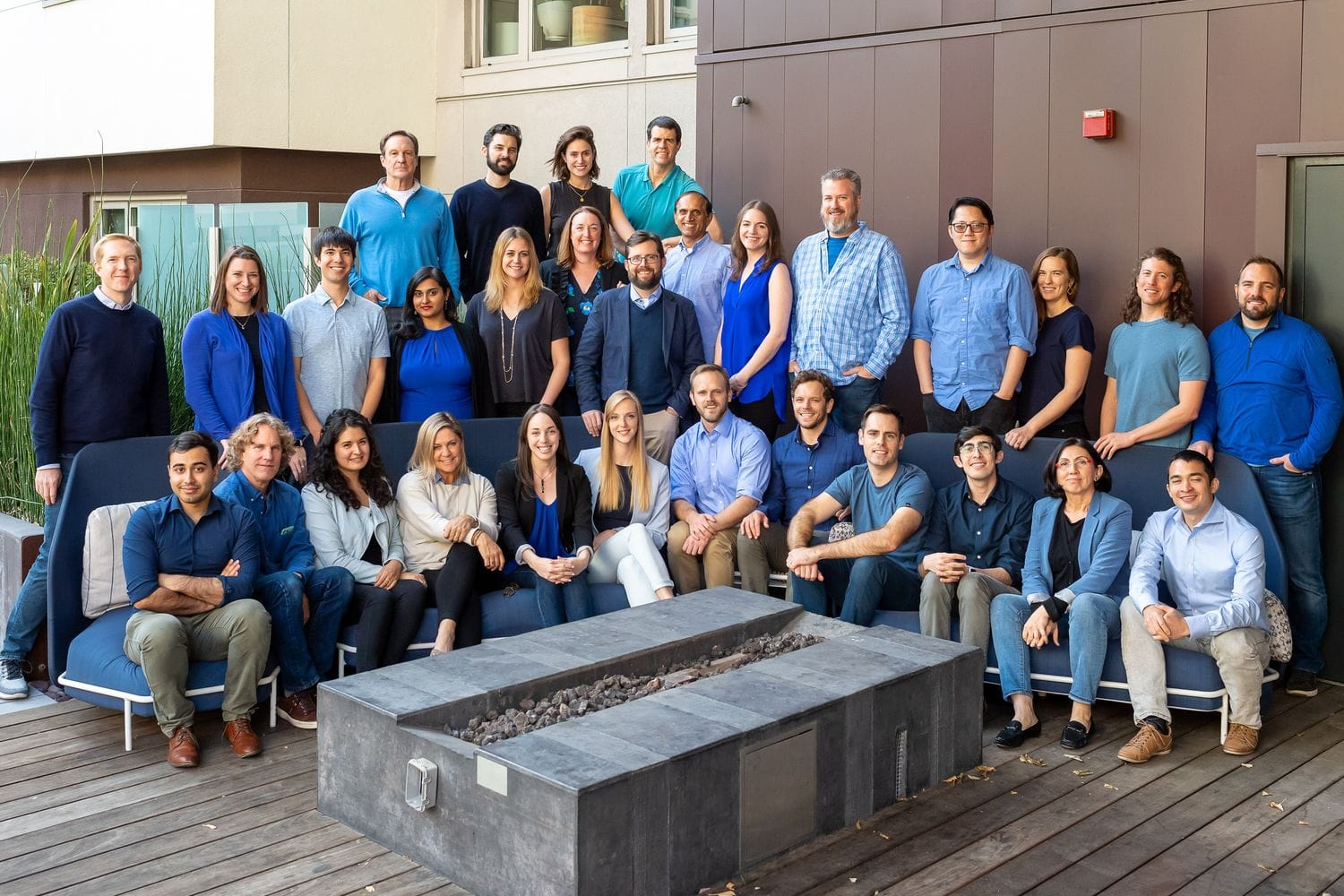 OhmConnect team wearing shades of blue
