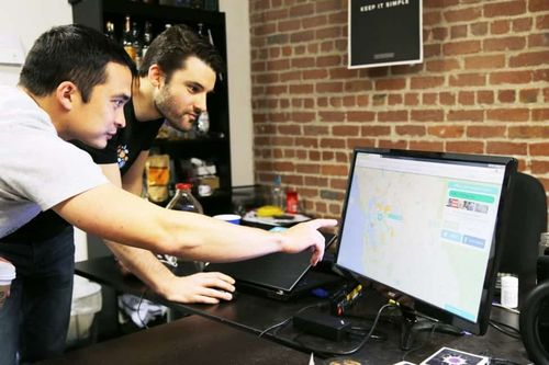 Two men working looking at the PC - category image for jobs