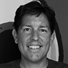 Photo of Bill Cushard, General Manager of Learndot at ServiceRocket in color gray.