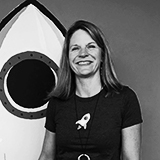 Photo in gray of a female ServiceRocket worker with the symbol of the company (a rocket).
