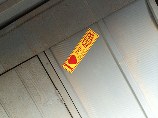 Photo of a garage door with a DP bumper sticker stuck to it