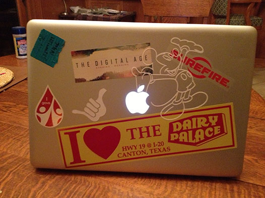 Photo of a laptop with a DP bumper sticker stuck to it