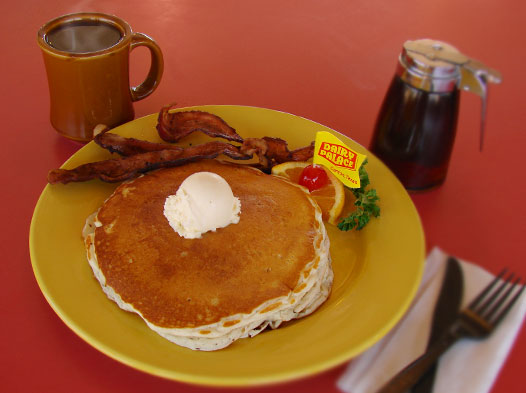 Photo of a breakfast of hot, fresh pancakes