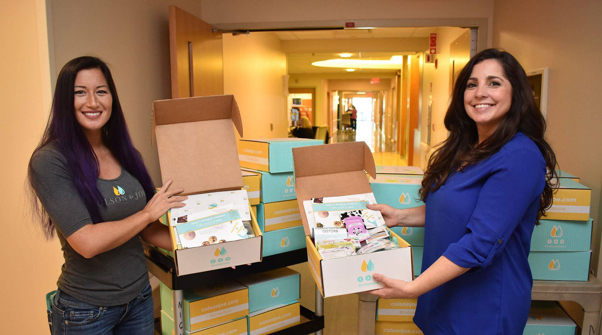 Naomi and Jessica giving away Colson & Joe subscription boxes in the NICU in Tampla, FL