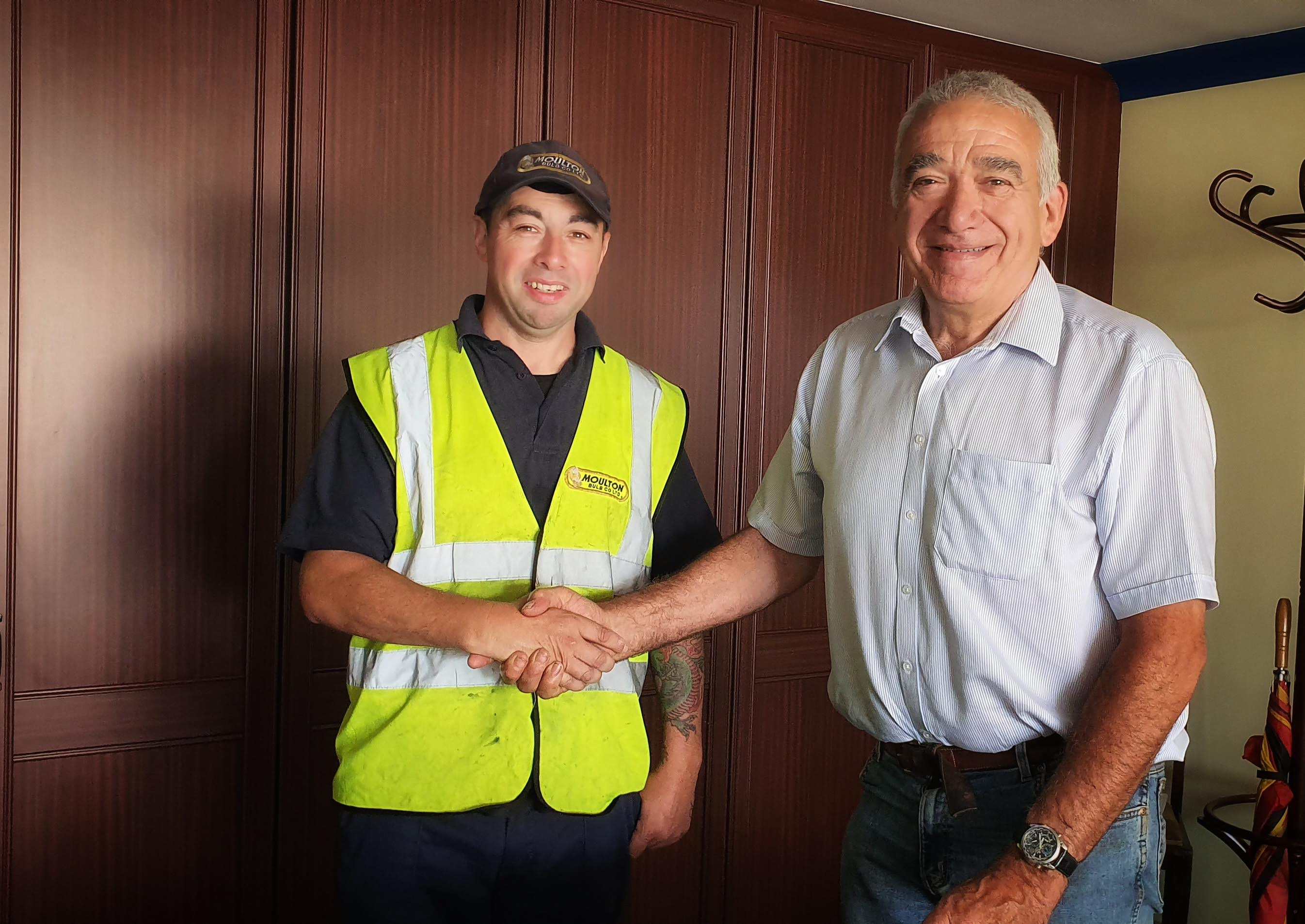 Dez Croft congratulated by Robert Oldershaw for his long service award