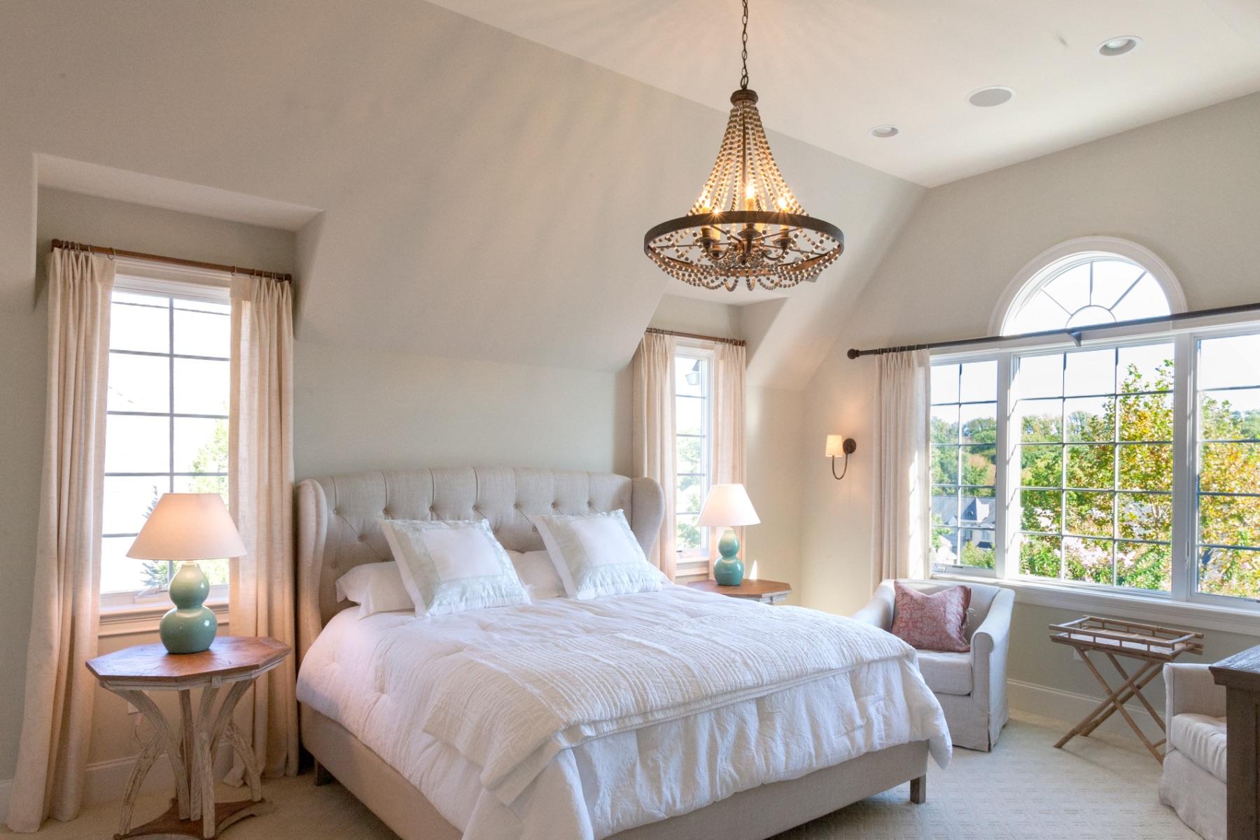 A sun-filled master bedroom at Haverford Reserve