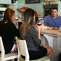 women drinking wine at the bar, palm coast, european village,