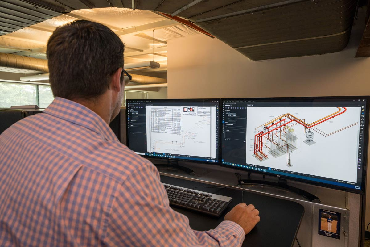 An M&E employee working on detailing with the use of CADD and 3D modeling