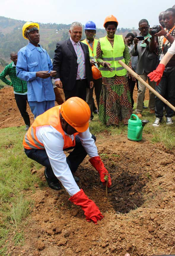 Northern Province Governor Jean Marie Vianney  Gatabazi plants a tree of partnership at the ground-breaking of the Butaro Cancer Patient Support Center in Rwanda.
