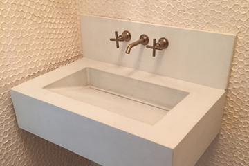custom concrete sink with artsy wall