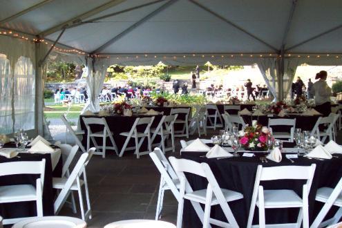 black table cloth with white napkins wedding set up