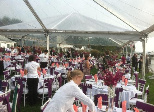 staff setting up tables for an event