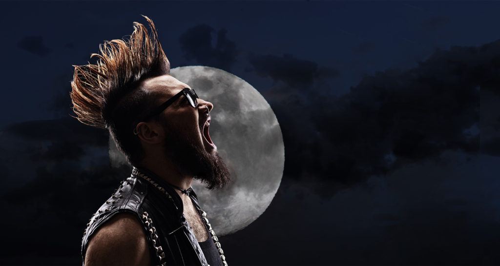 Man with mohawk screaming in front of the full moon