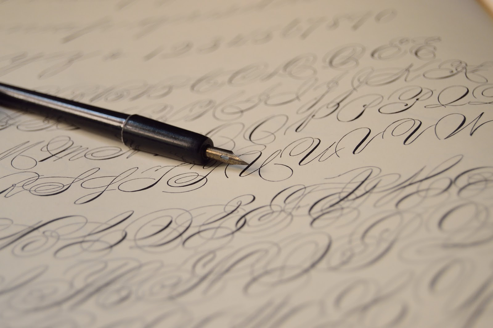 Image of calligraphy pen and writing.