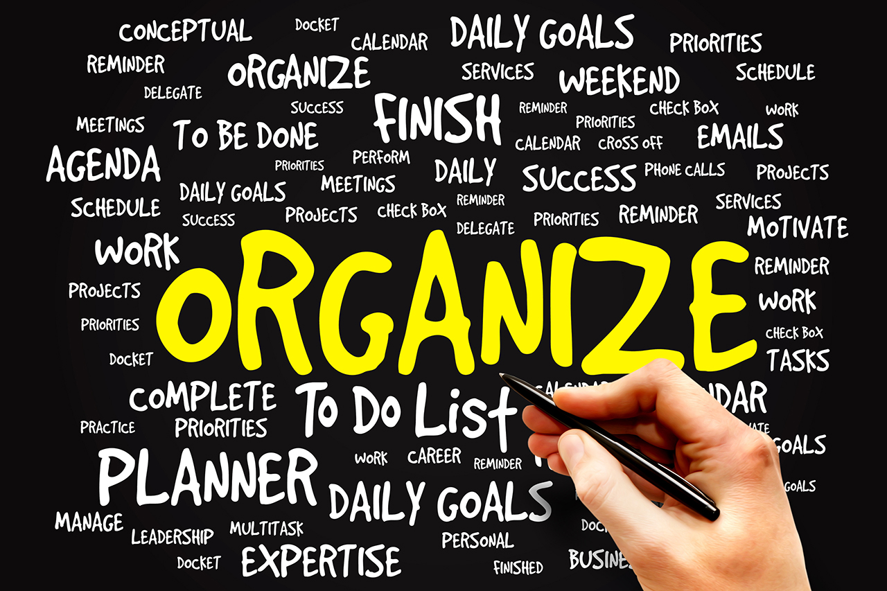 """""""Organize"""" in yellow surrounded by white words with descriptive words of organization"""