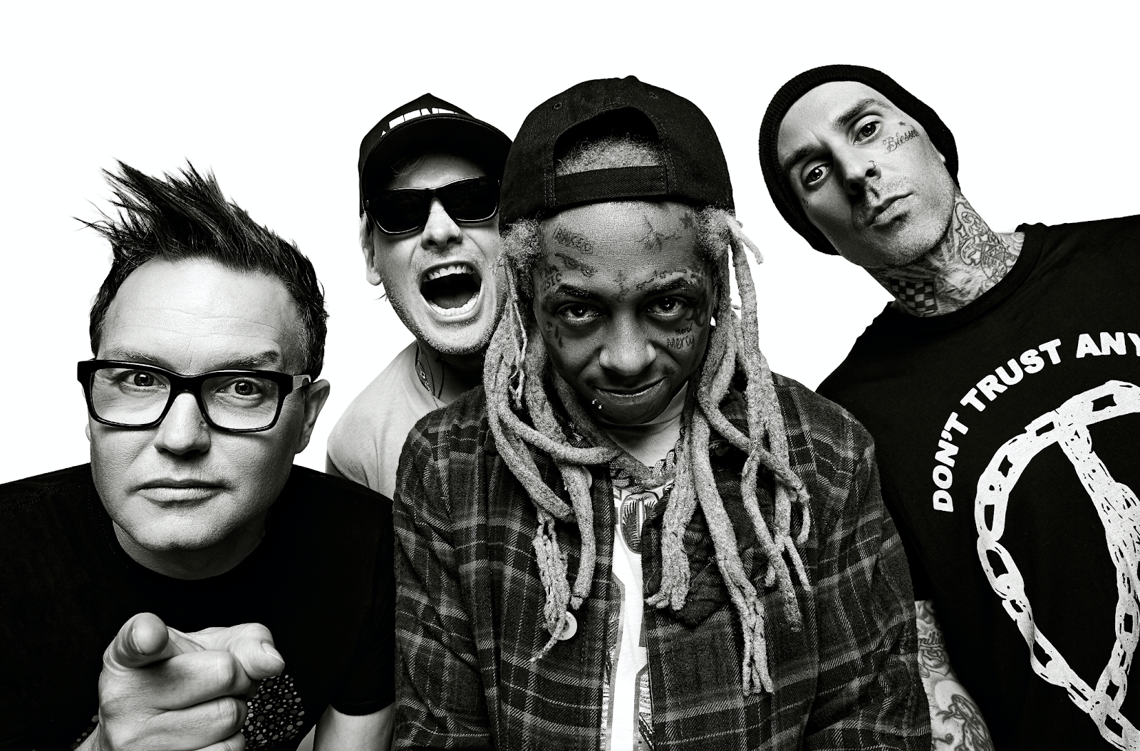 Blink-182 and Lil Wayne posing for a group picture while all staring at the camera.