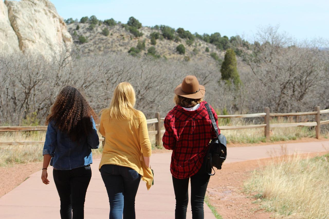 Three women walking through nature