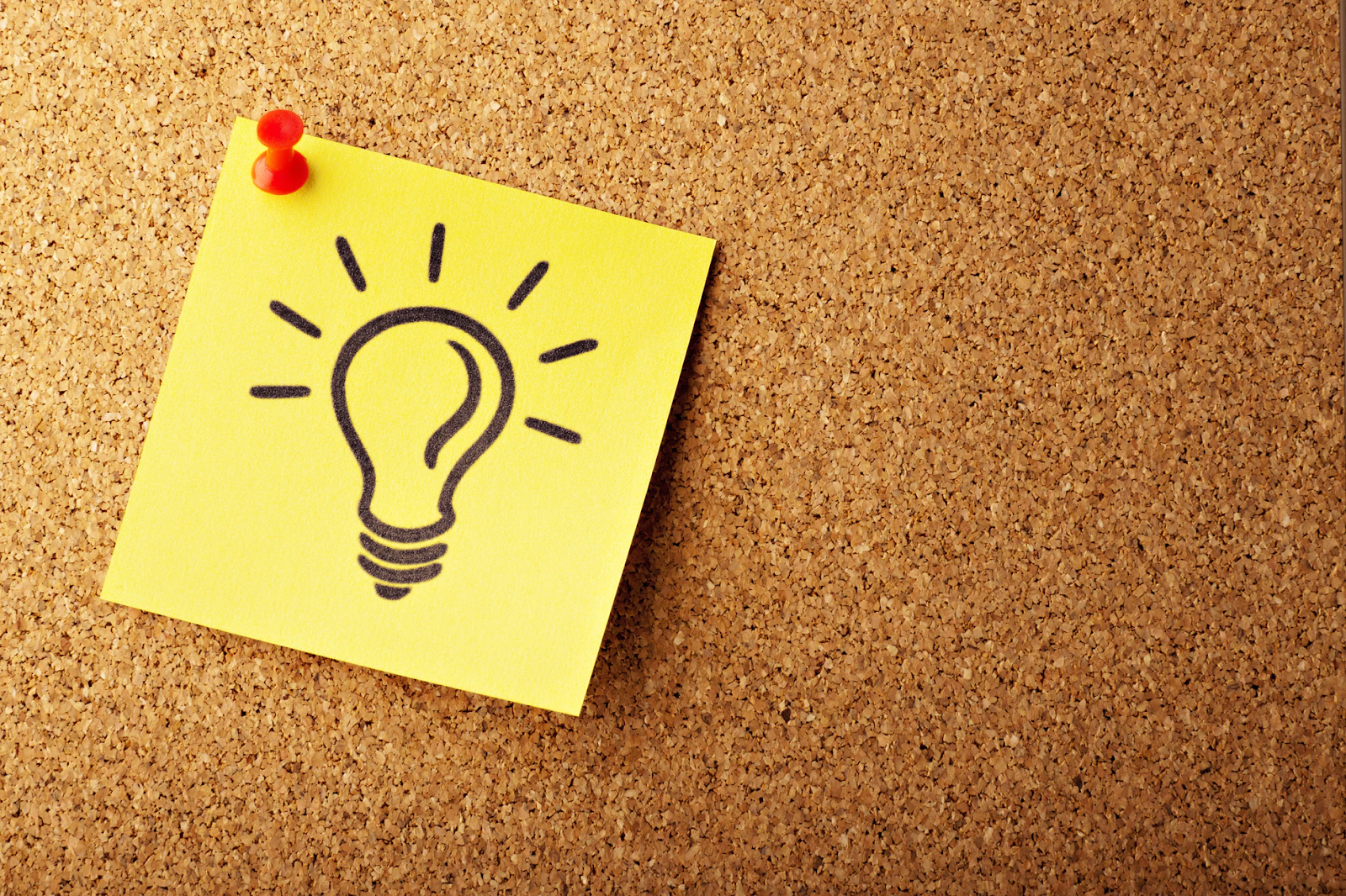 pinned post-it with light bulb on it
