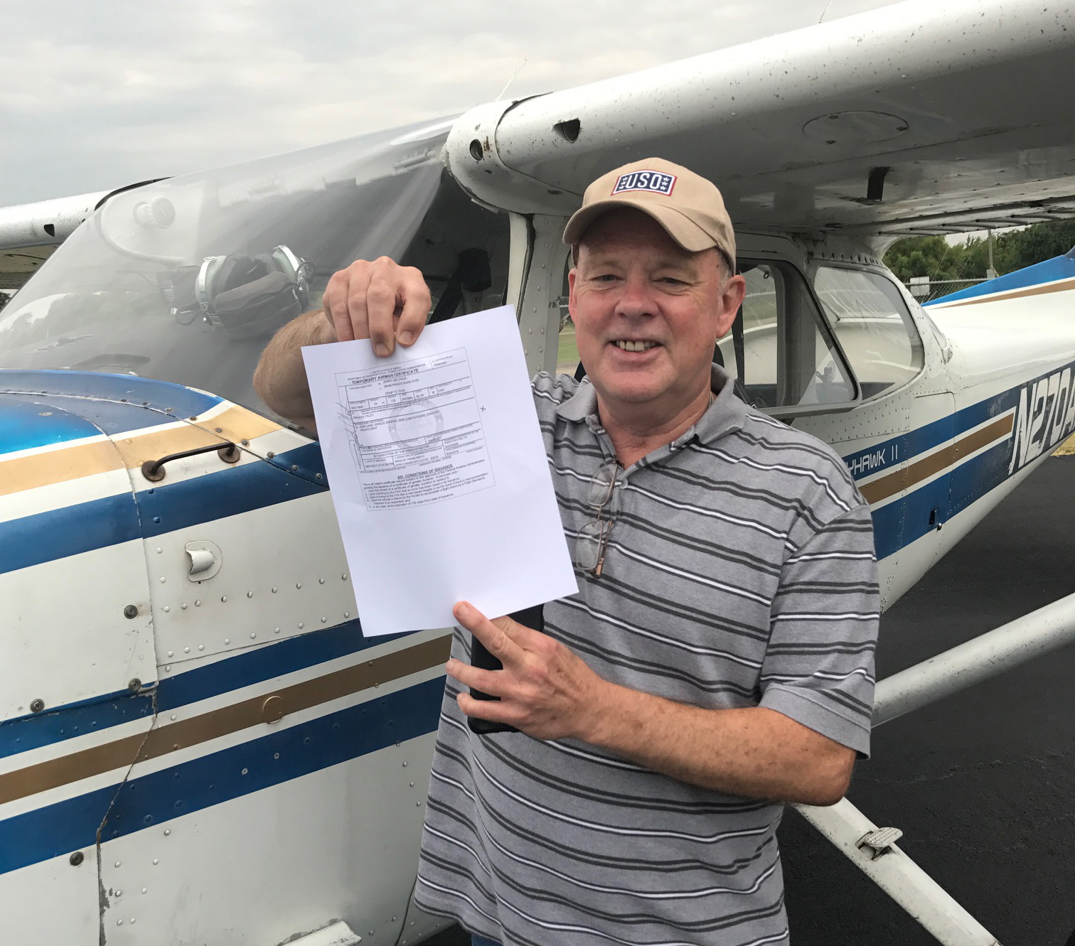 Photo of a Code 1 flight student earning their private pilot certificate