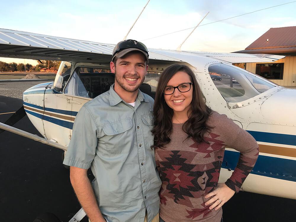 Photo of flight students standing next to a Cessna 172 Skyhawk