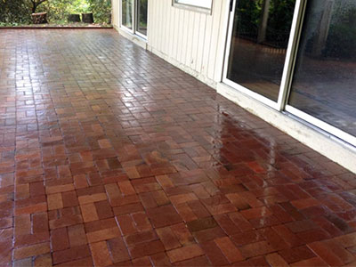 Patio pressure washed by Atlas Services