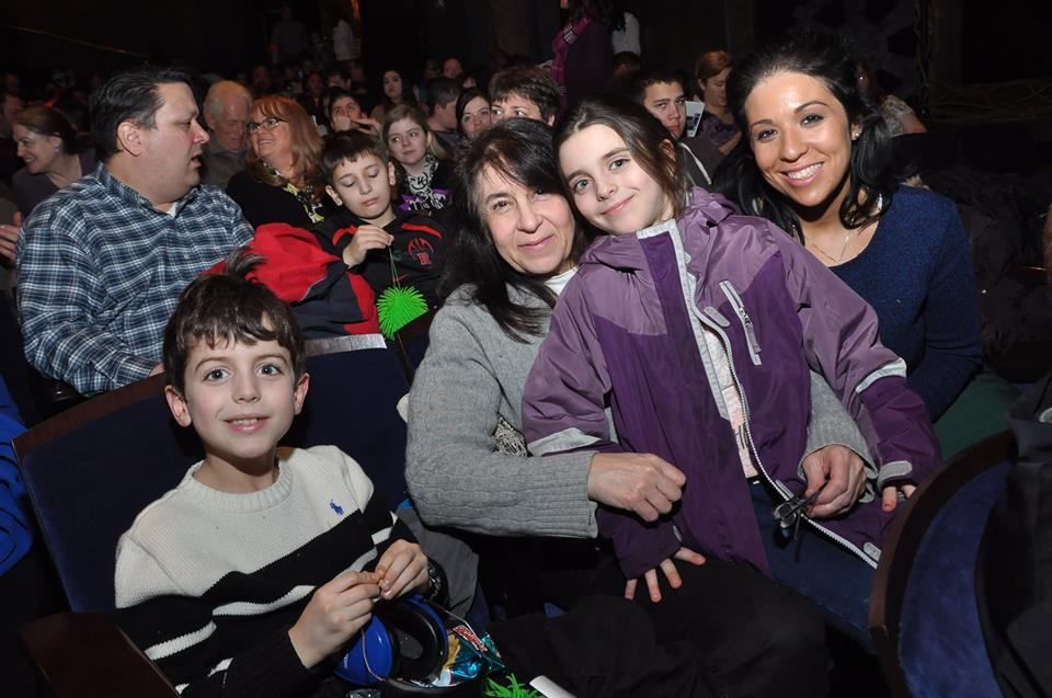 "Theatre Development Fund ""Wicked"" Autism Theatre Initative photo of families seated in theatre"