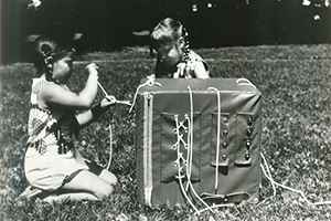 Children Playing With a Development Cube