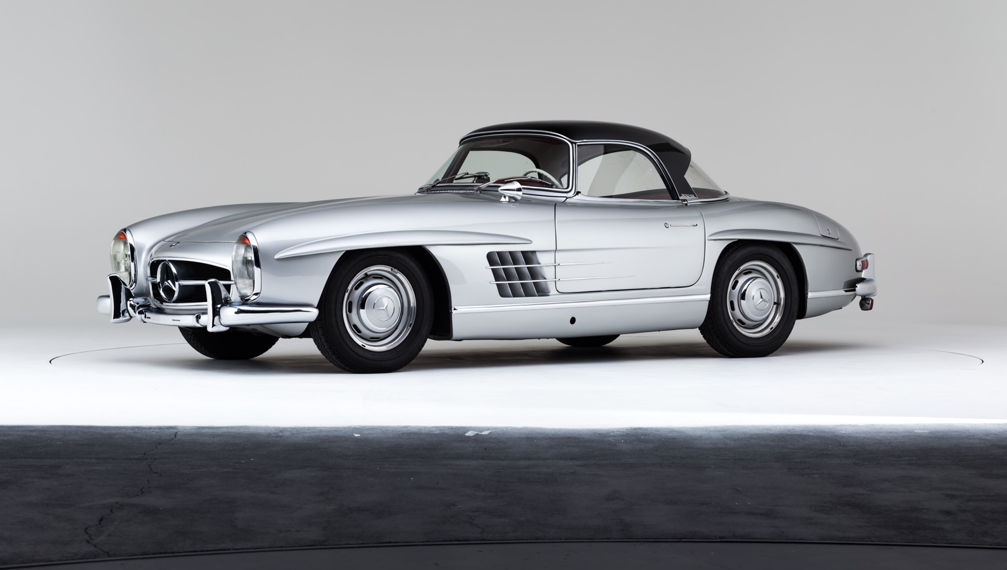 Classic Mercedes-Benz W198 300SL Roadster in silver with red interior and black  hardtop