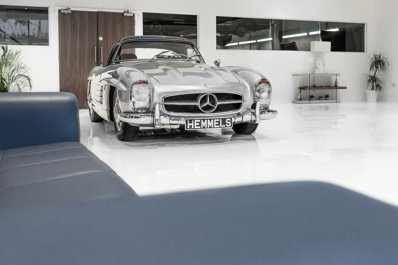 Silver Mercedes-Benz 300SL Roadster in the Hemmels showroom