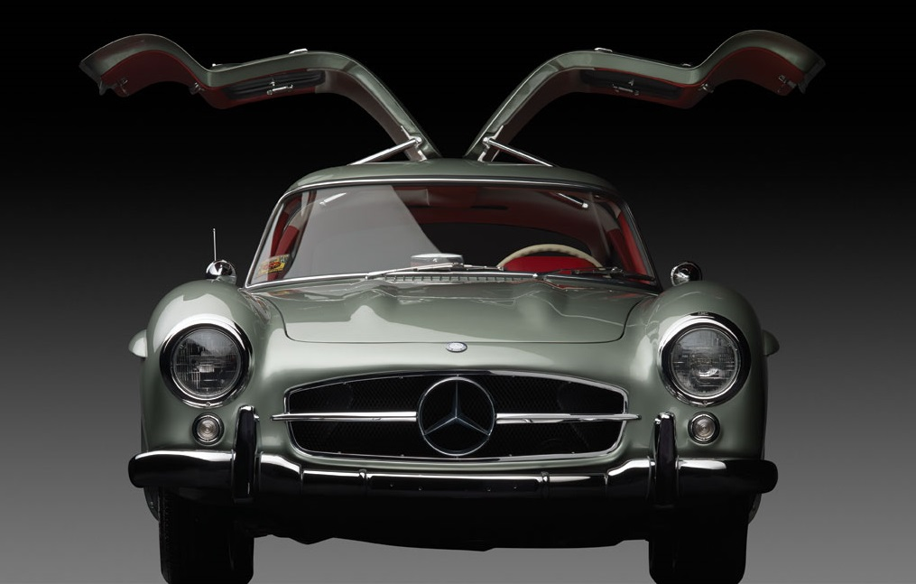 Classic Mercedes-Benz W198 300SL Gullwing front view doors open in silver with red interior