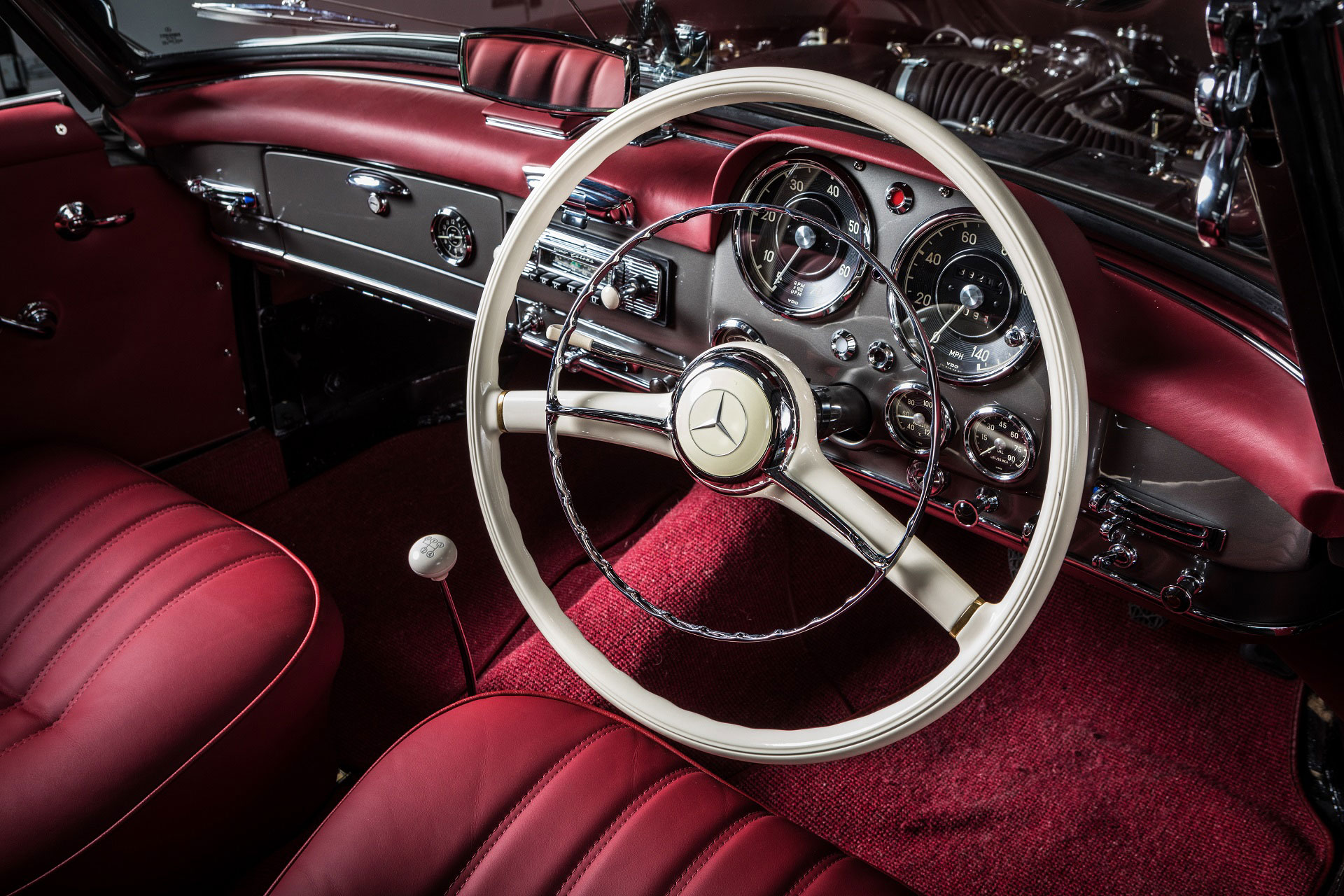 Classic 1963 Mercedes-Benz W121 190SL Roadster with red interior