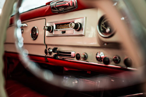 Classic Mercedes-Benz W121 190SL Roadster with red interior