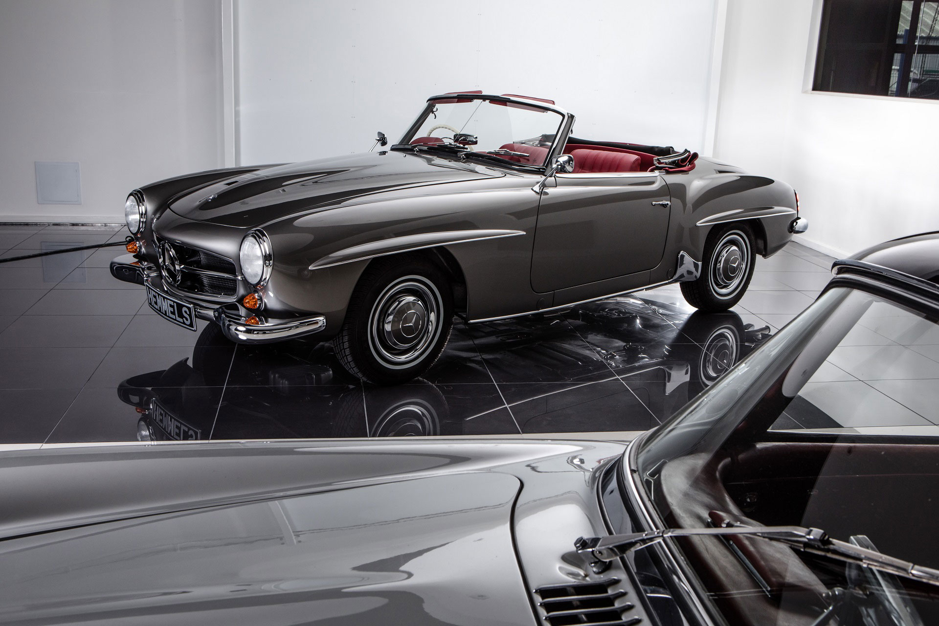 Classic 1963 Mercedes-Benz W121 190SL Roadster in Anthracite with red interior showroom with gullwing