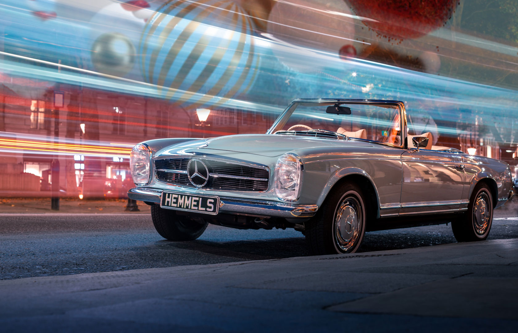 Classic Mercedes-Benz W198 300SL Roadster in silver with red interior and black hardtop in Cardiff