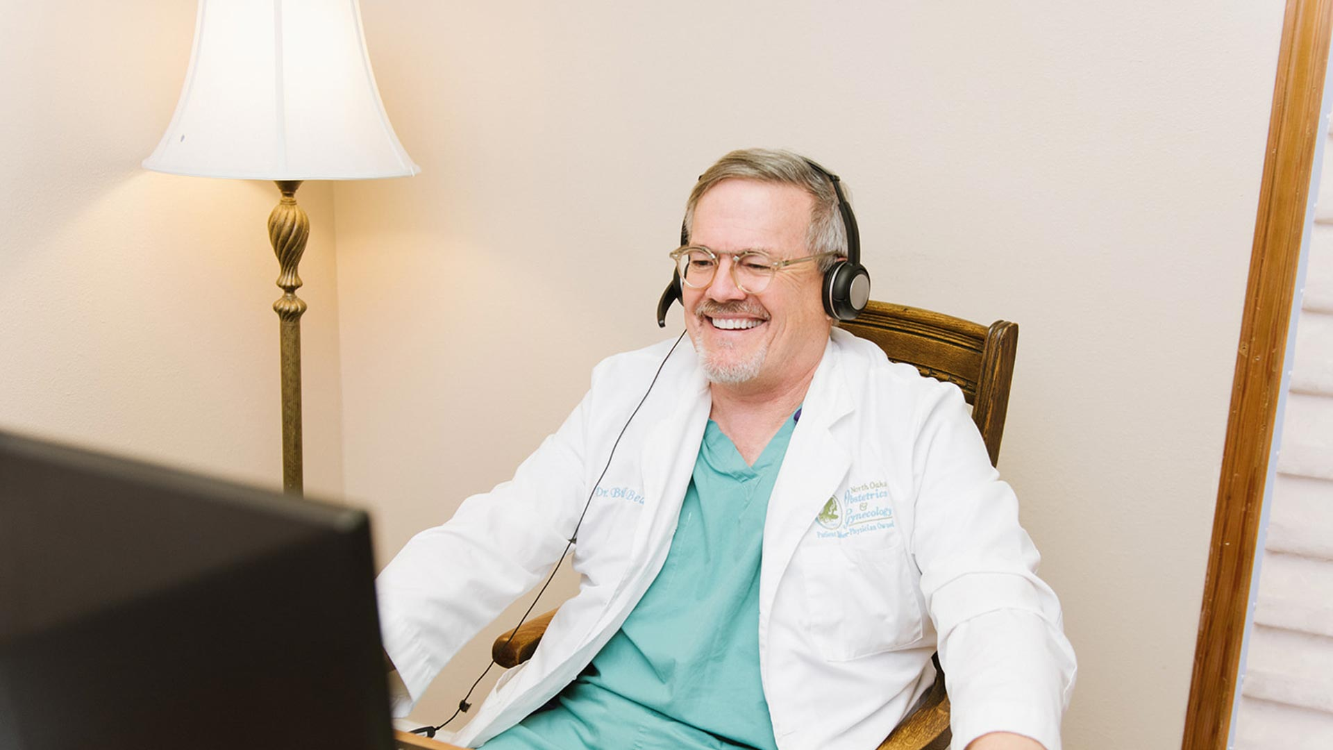 Dr. Beacham having a remote meeting at North Oaks OBGYN with a patient.
