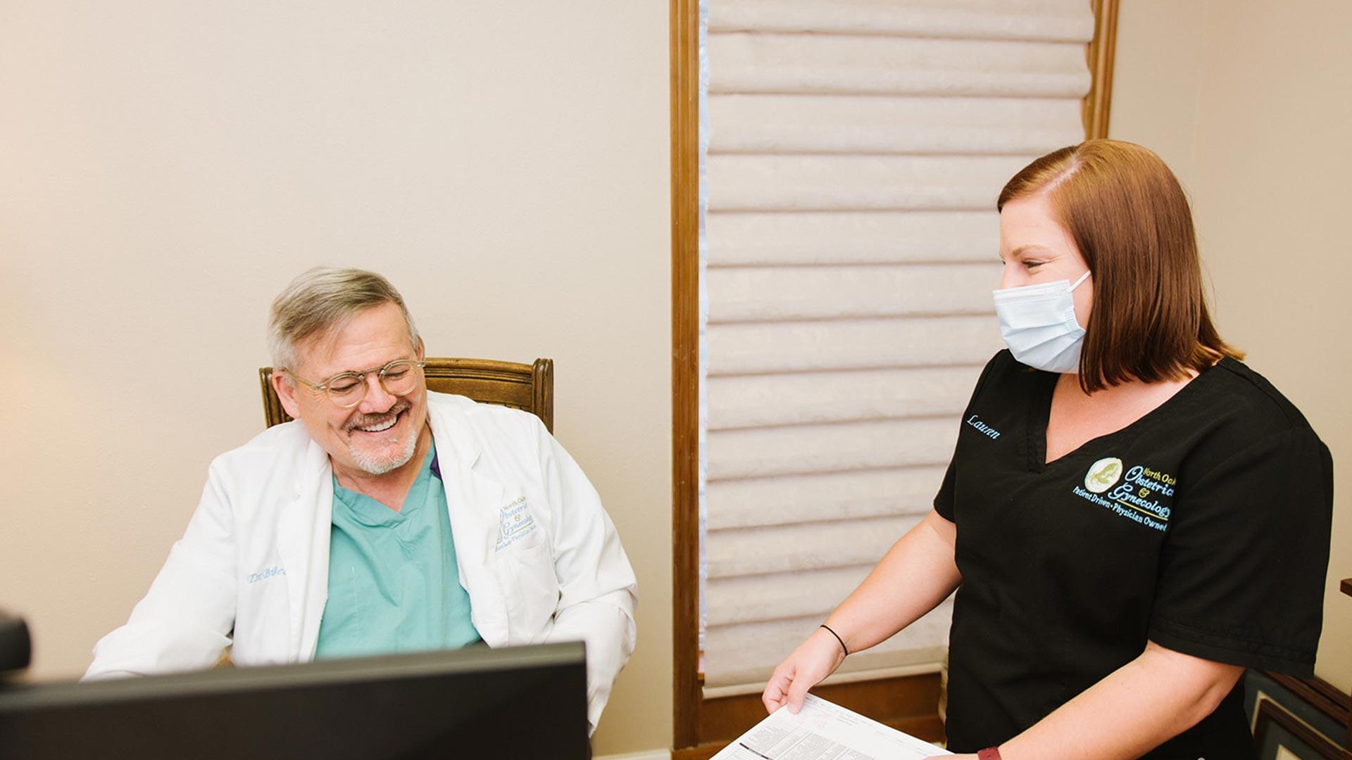 Dr. Beacham and nurse Lauren at North Oaks OBGYN.