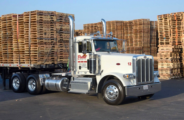 Photo of truck loaded with wood pallets