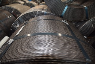 removing straps from steel  coils