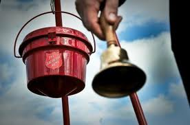 Salvation Army bell ringer and bucket