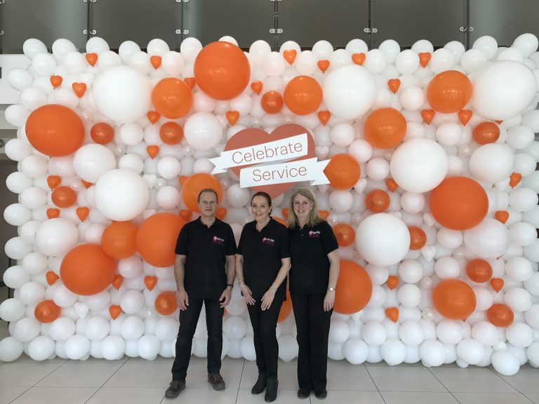 orange and white balloon wall