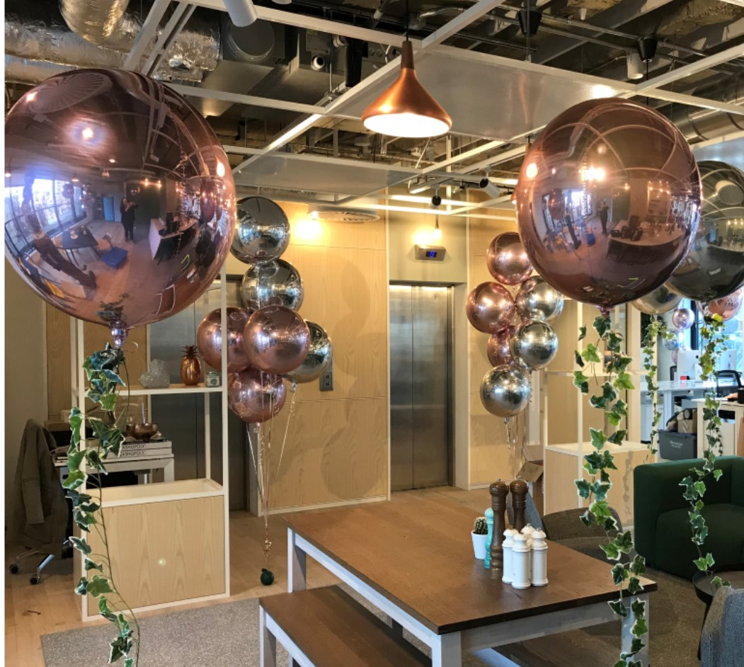 Collection of branded sphere balloons in coffee shop
