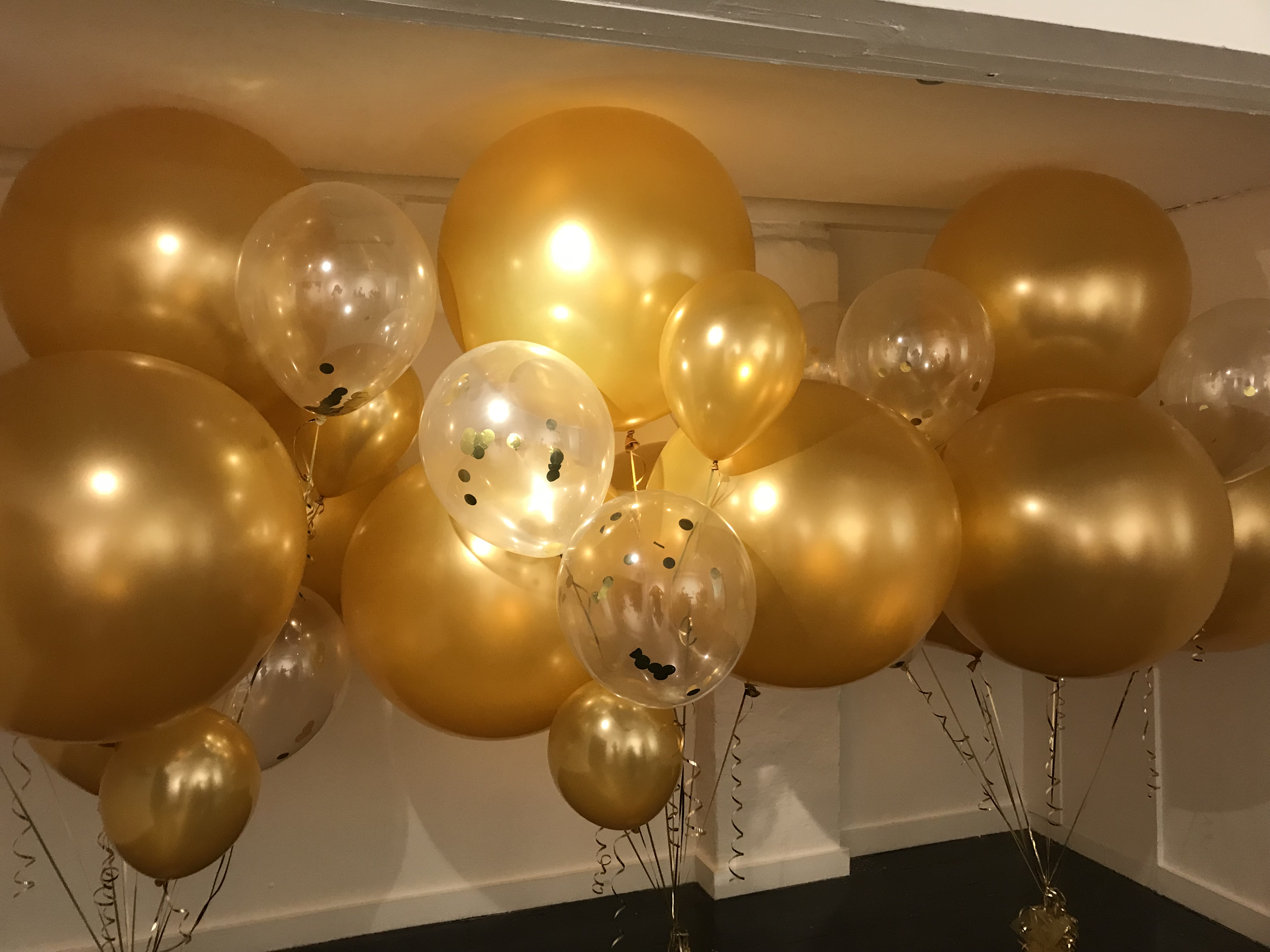 Large gold balloons designed for a fashion launch