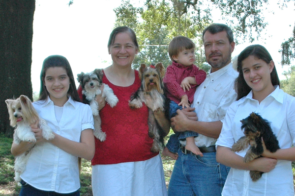 family holding puppies