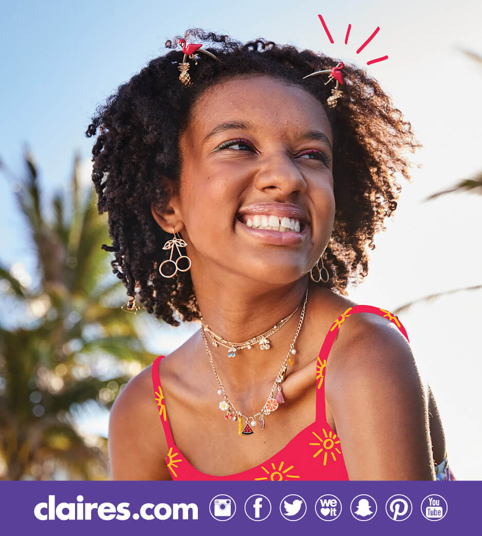 Young woman wearing various Claire's accessories
