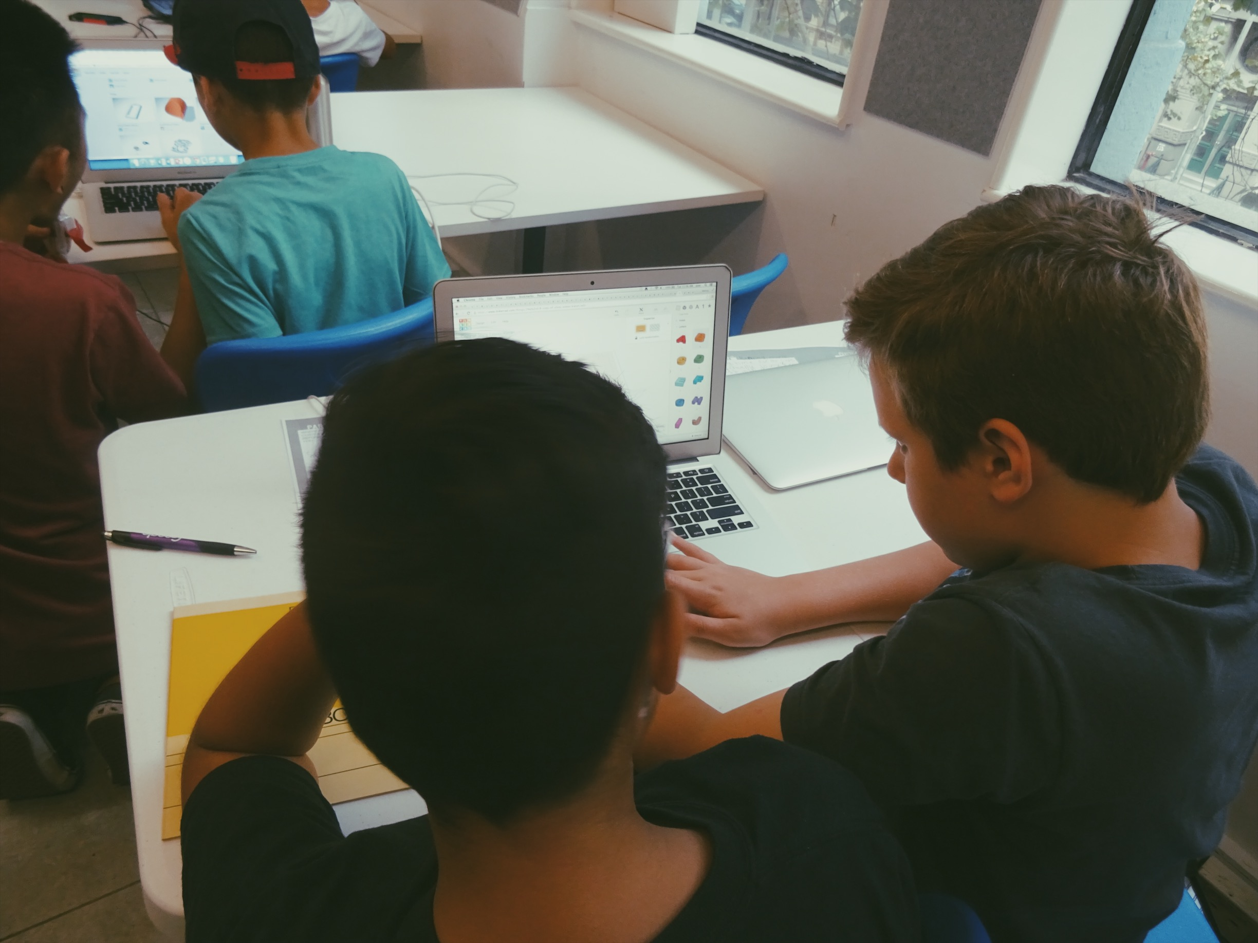 Lemonade Stand Kids AR: two boys work on a model in Tinkercad